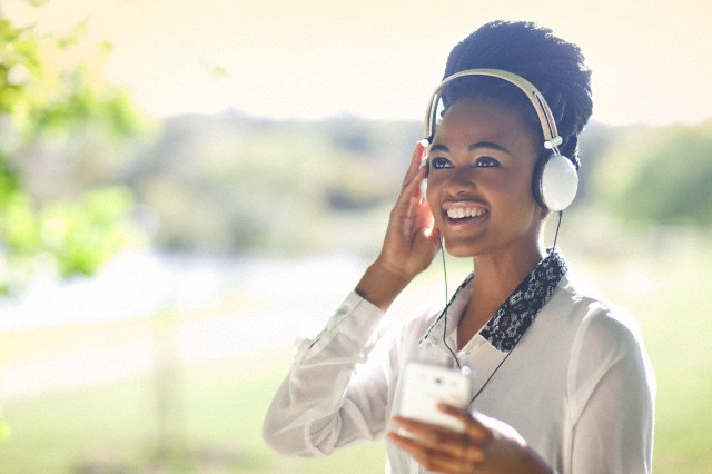 Woman wearing headphones listening to music