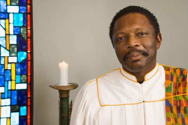 African American man wearing church choir gown