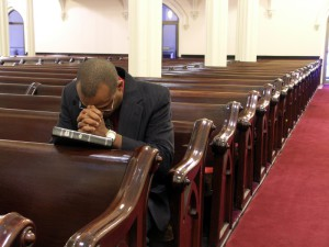 blackmanprayingatchurch