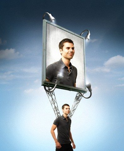 Man walking with billboard of himself strapped to his shoulders